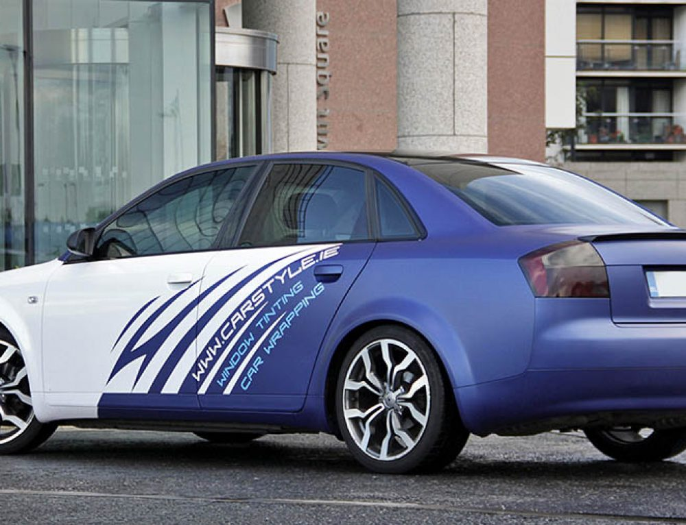 Audi A4 white pearlescent and blue wrap